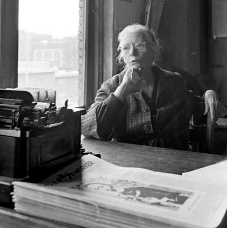 Dorothy Day at the typewriter in the office of the Catholic Worker in New York in the 1950s.