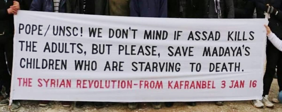 Banner protesting starvation in Medaya, Syria