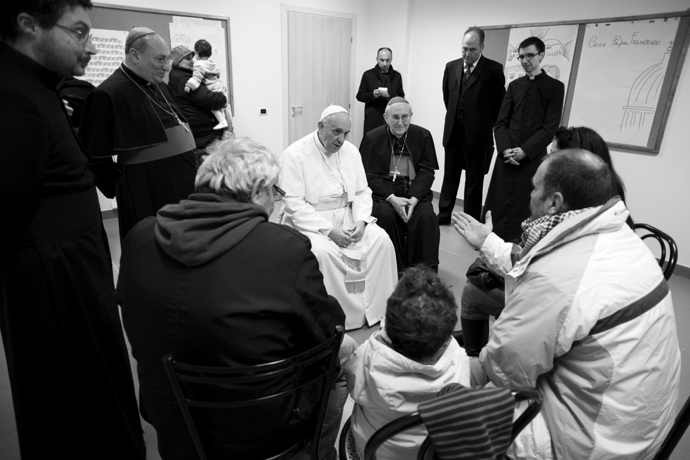 Pope Francis visits with homeless people in Rome and listens to their stories.